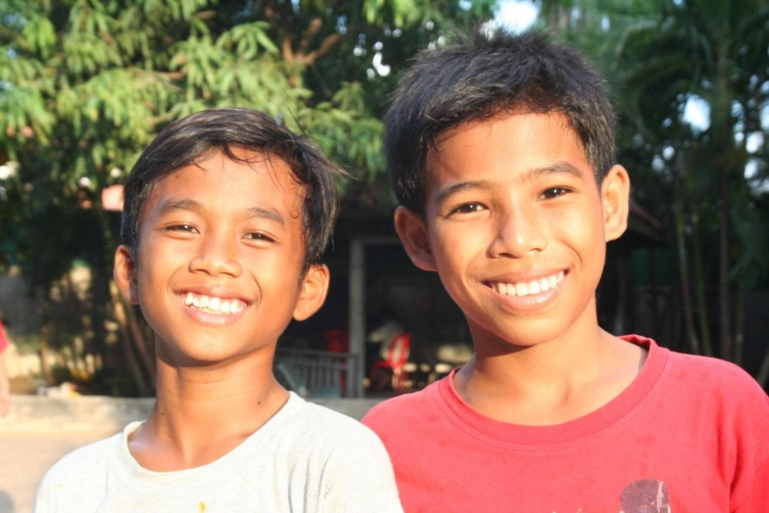 Kids smiling at the camera in Cambodia